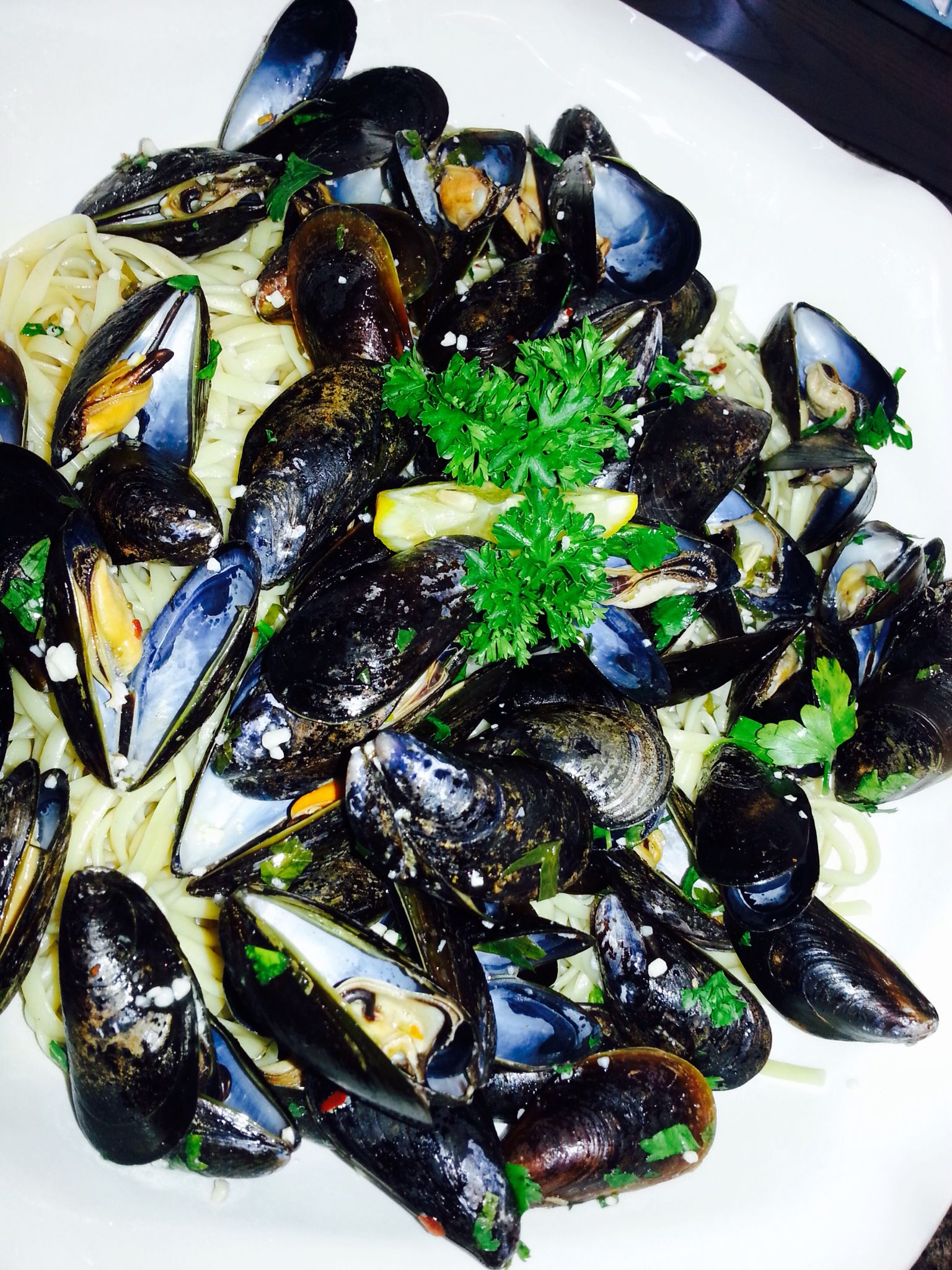 Fresh, Hot, Delicious Mussels Over A Hot Bed Of Linguine In A Garlic Butter Wine Sauce