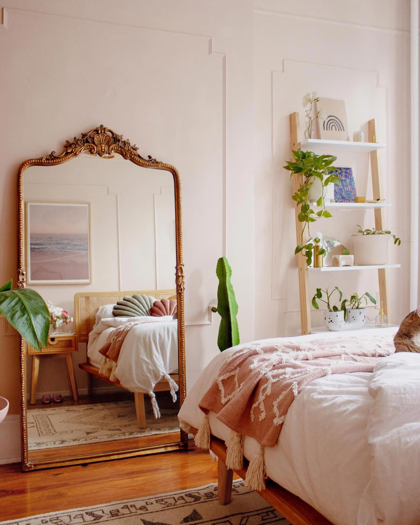 """A tiny room made to feel bigger thanks to this mirror and David's plea to rearrange a bedroom so small that I didn't think there could be any other layout options. People comment all the time about how """"large"""" our apartment seems, and I �� every time since I know the truth.. IT SMALL. #vintagebedroom"""