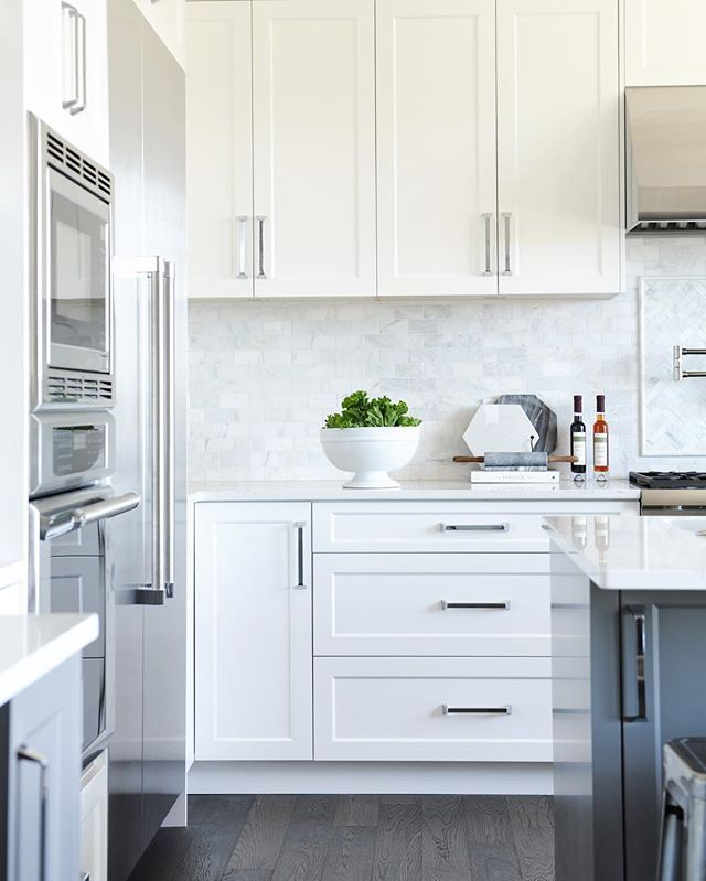White Shaker Panel Cabinets + Dark Grey Island + Marble