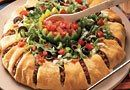 Taco Ring  For recipe:  https://www.facebook.com/photo.php?fbid=510896335614259&set=a.475293779174515.93119.432606490109911&type=3&theater  http://www.pamperedchef.biz/labritta