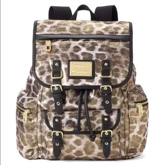 Juicy Couture Glitter Leopard Print Backpack Gold LEOPARD BROWN GLITTERY  All about fashion, this trendy Juicy Couture backpack showcases glittery leopard accents. In multi. PRODUCT FEATURES Glittery leopard design PRODUCT DETAILS 13''H x 10.25''W x 5.5''DTop handle: 3''Top handle & adjustable straps Magnetic snap & drawstring closures Exterior: 3 zip pockets & magnetic snap slip pocket Interior: 2 slip pockets & zip pocket Fabric, faux leather Juicy Couture Bags Backpacks