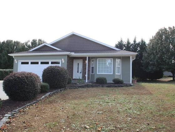WHAT YOU SEE IS WHAT YOU GET and boy are you going to be happy  New roof siding and gutters in 2011.  New front door garage door and disposal in 2013.  You can see this home has been well maintained and is move in ready Irrigation large garden area extra parking pad and the 16x16 two story storage building make this an exceptional property.  Front living room opens into the kitchen that overlooks the den and sliders to the patio.  Privacy at the rear created by large Leland cypress trees…