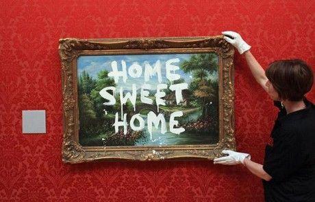 "Bansky's graffiti art ""Home Sweet Home"""