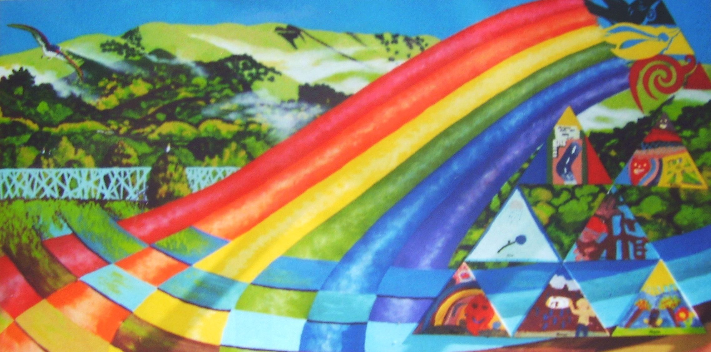 Mural designed and painted by Ellen with triangular pieces of board, painted by pupils, attached. Left hand panel of two, each 240cm x 120cm, attached either side of hall entrance, Otari School, Wilton, Wellington .