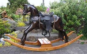 Image from http://www.rockinghorses.net.nz/Large%20carved%20rocking%20horse,dark%20oak%20colour,gloss%20finish.JPG.