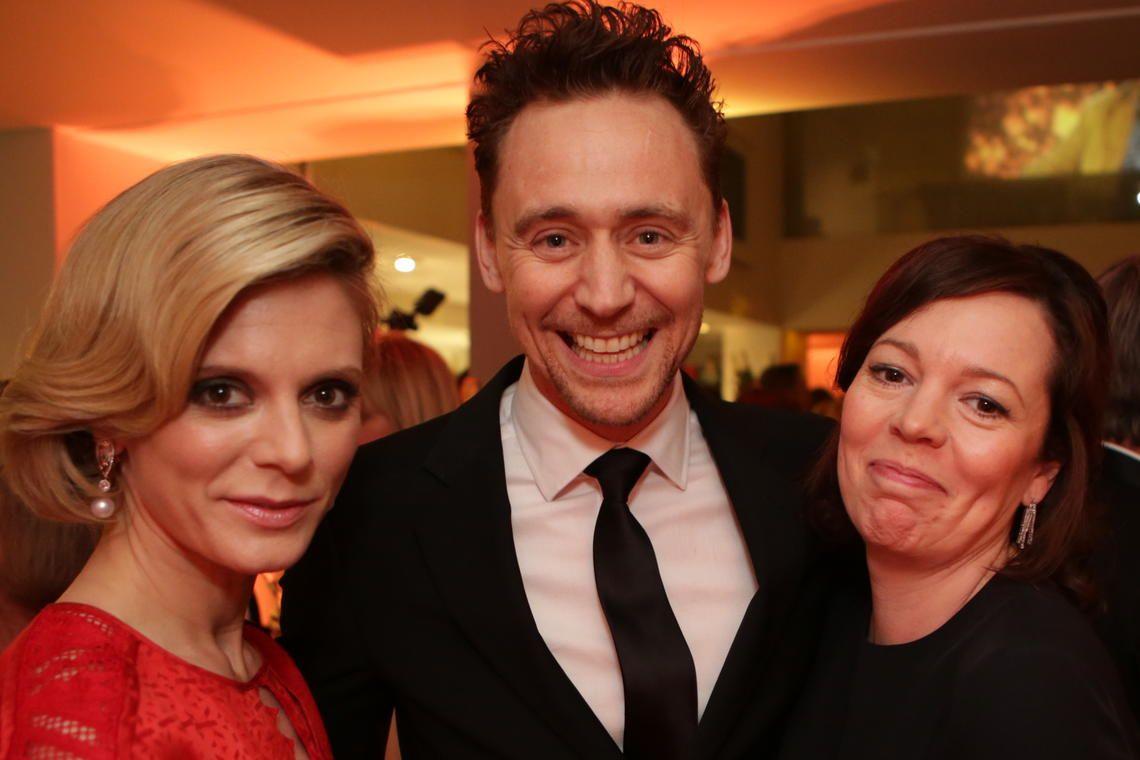 Emilia Fox, Tom Hiddleston and Olivia Colman post for the camera