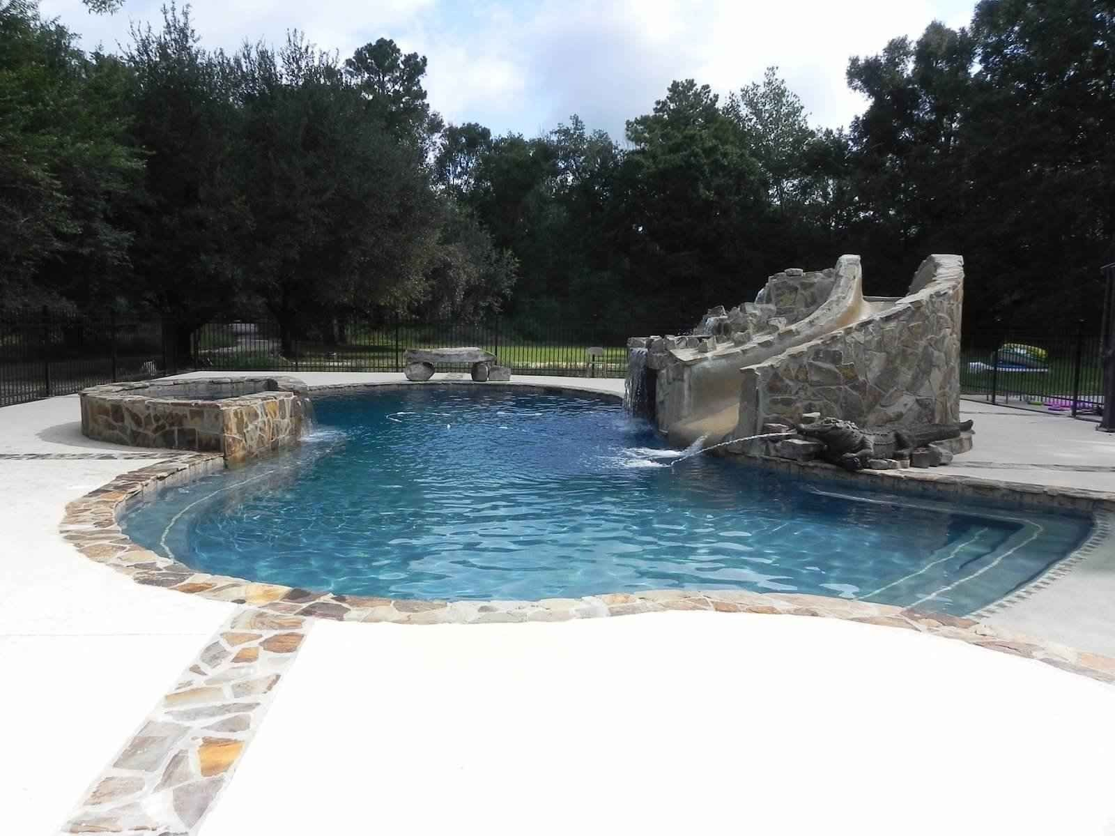 Pool gunite pool with a custom waterfall slide and for Swimming pool waterfalls construction