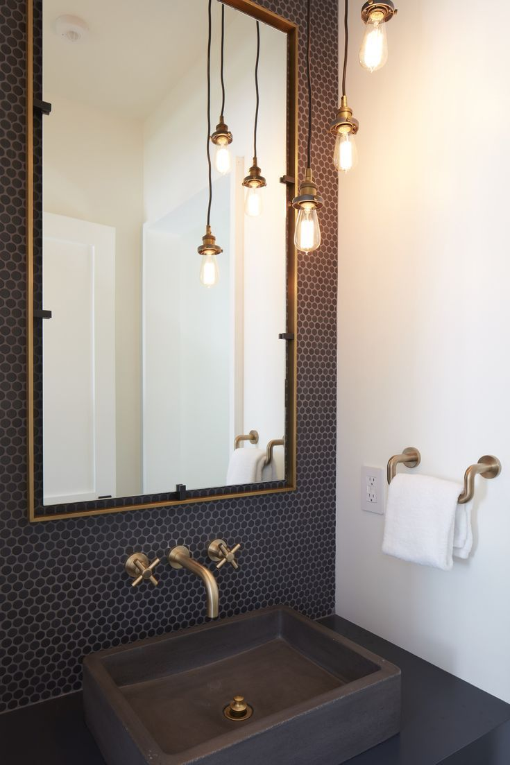 Photo of In love with this black mini-hex mosaic wall tile and accented with matte gold w…