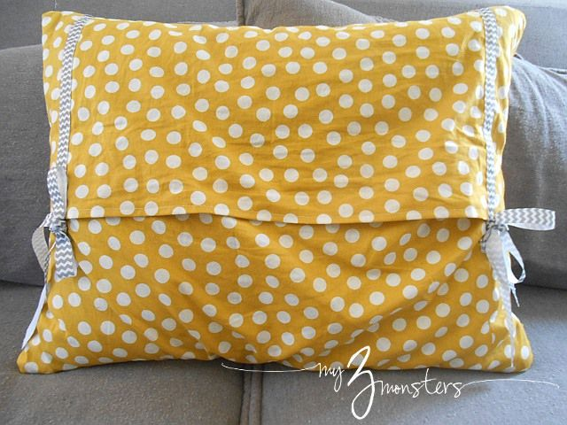 My 3 Monsters: Spring Spruce Up: New Pillow Covers  Like the bows used for closure...
