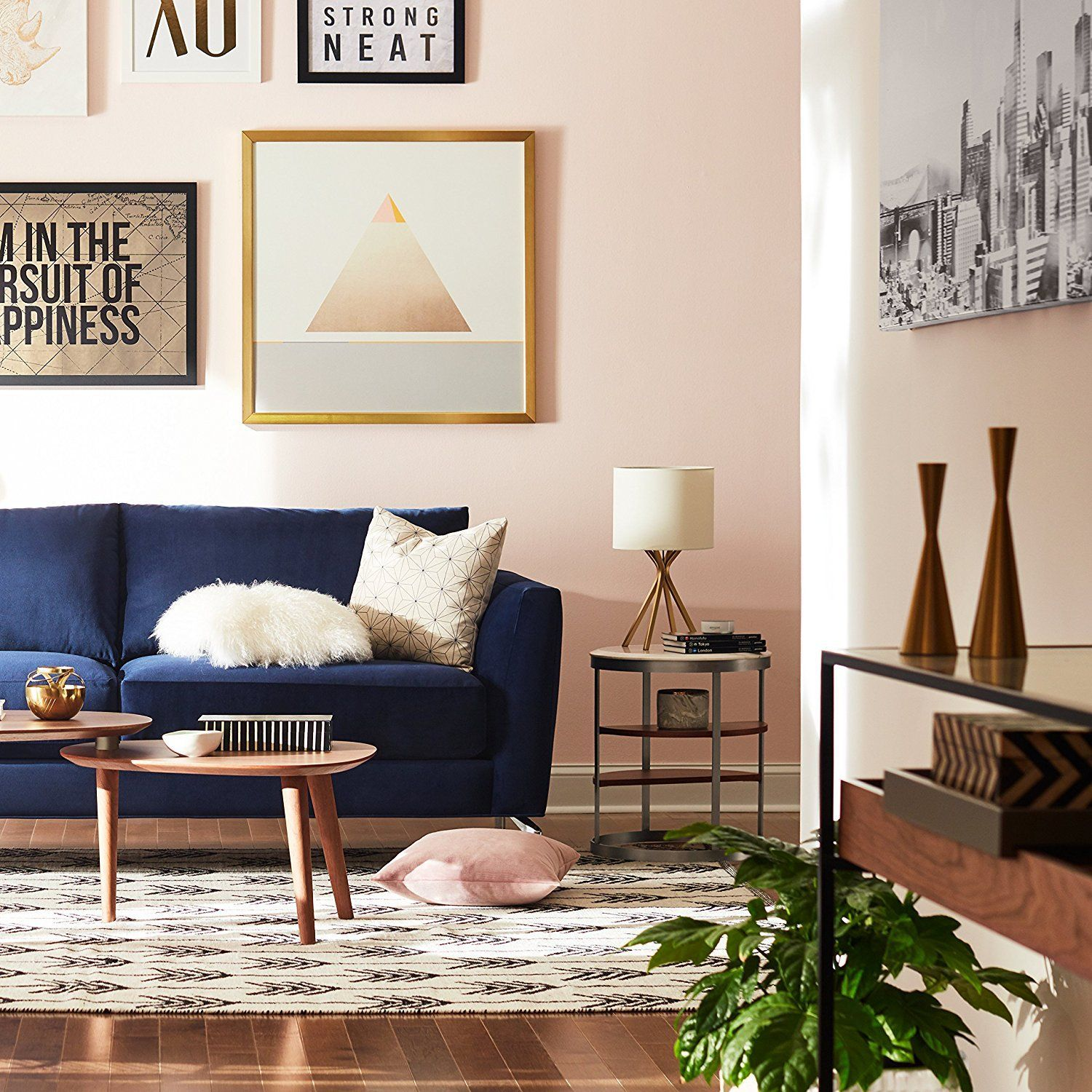 Blush Wall Color With A Navy Blue Couch Giving The Look A Perfect Calm Modern Living Room Style Blue Sofas Living Room Blue Couch Living Room Blue Couch Living
