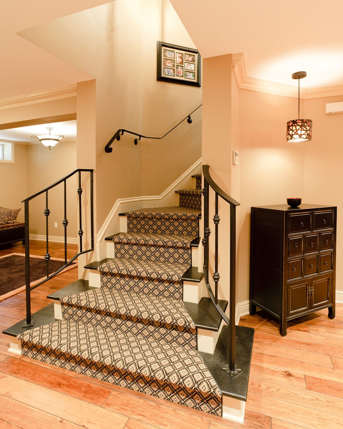 Elegant Basement Entry Staircase With Handmade Wrought