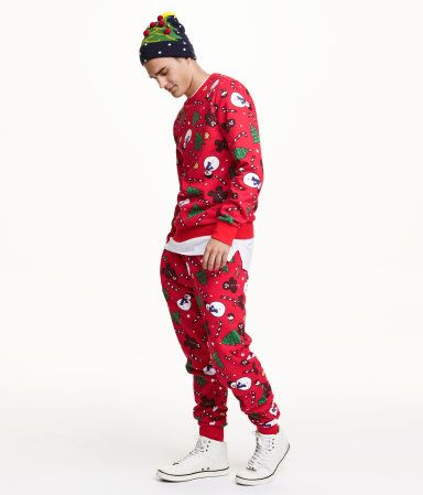 Holiday print, jogger-style pants in patterned sweatshirt fabric with an elasticized drawstring waistband. Side pockets, back pocket, and ribbed hems. Soft, brushed inside. | H&M Divided Guys