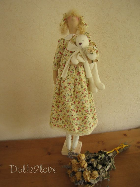 Tilda doll Hollie wearing a pale yellow dress with a by Dolls2love
