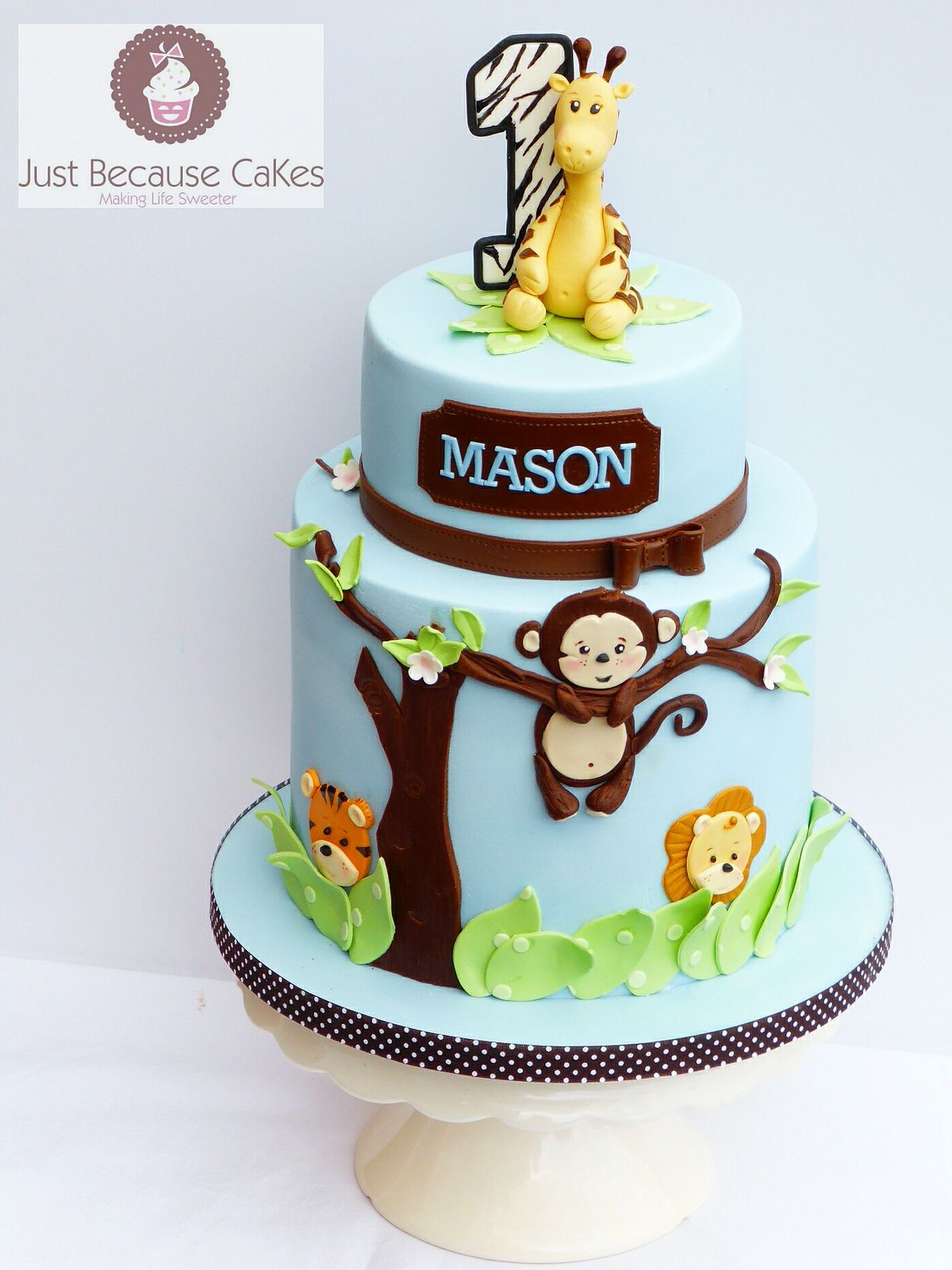 Jungle animals first birthday cake for a boy A giraffe a monkey a