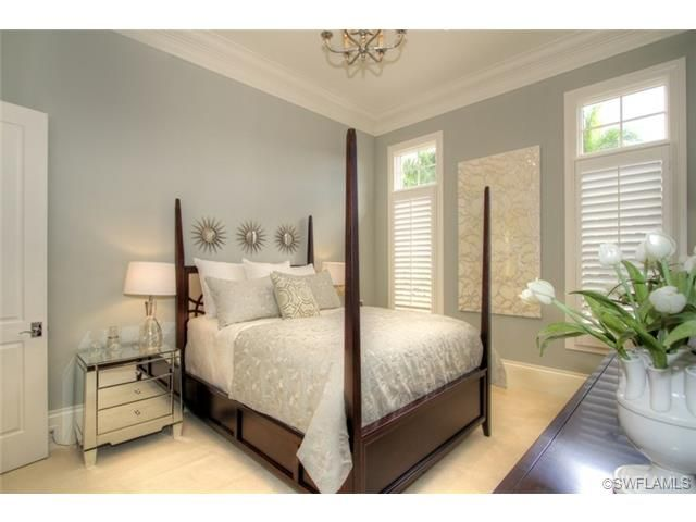 Gray Grey Silver Guest Room With Four Poster Bed And Mini Starburst Mirrors Mirrored Chest In Grey Oaks Napl With Images Naples Homes For Sale Guest Bedrooms Grey Oak