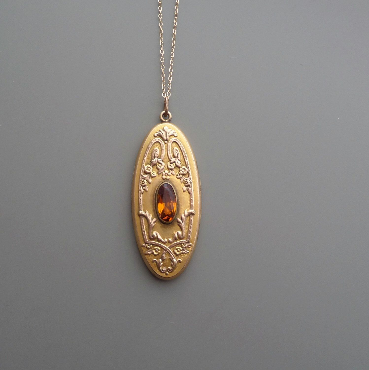 Antique Edwardian Locket. 1913. Amber Glass. Floral. by pinguim on Etsy https://www.etsy.com/listing/171443650/antique-edwardian-locket-1913-amber