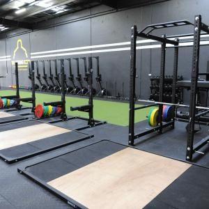 the strong room  gym interior gym design home gym garage