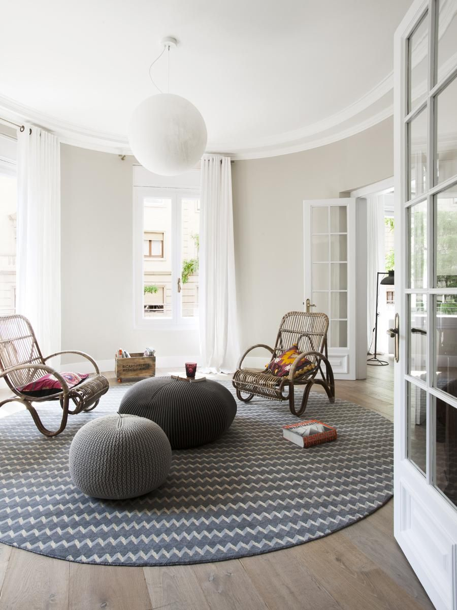 Apartments, Remarkable Contemporary Apartment Interior In Open Living Space With Rounded Shape Rug Rattan Chairs Cool Pendant Lamp Wooden Floor White Ceiling And Wall Connected To Kitchen: Contemporary Apartment Interior with Exquisite Decor