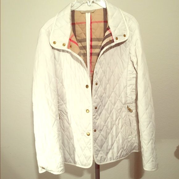 Burberry London White Quilted Jacket Authentic & Excellent condition.. It's so classic and withstands the test of time. Lightweight classic Burberry pattern on the inside. Burberry Jackets & Coats