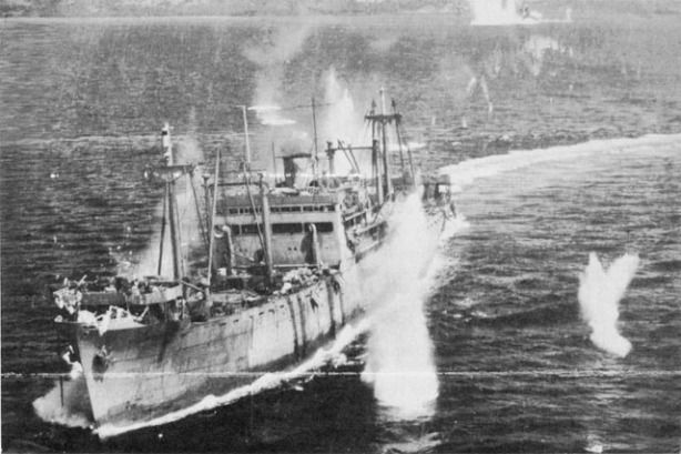 JAPANESE CONVOY UNDER ATTACK in Ormoc Bay. A large transport is straddled by bomb bursts