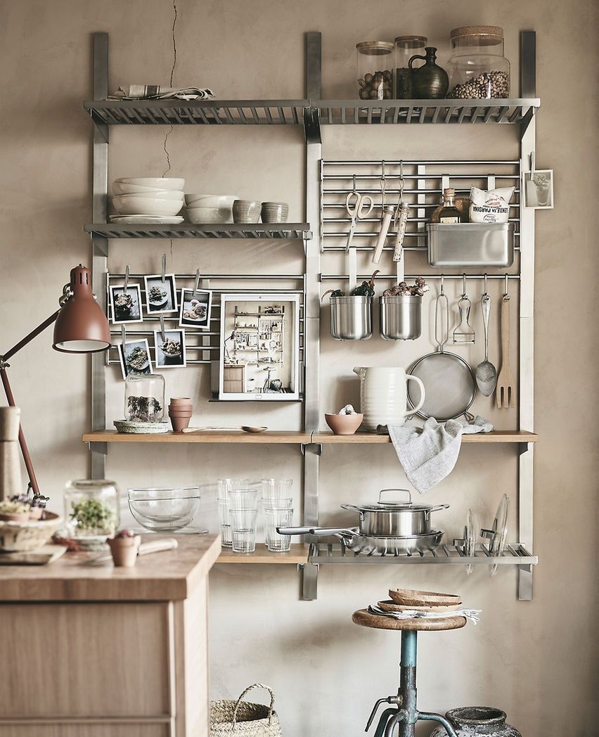 Kitchenware On A Wall Storage Unit Of Shelves Rails And Grids Compact Organized