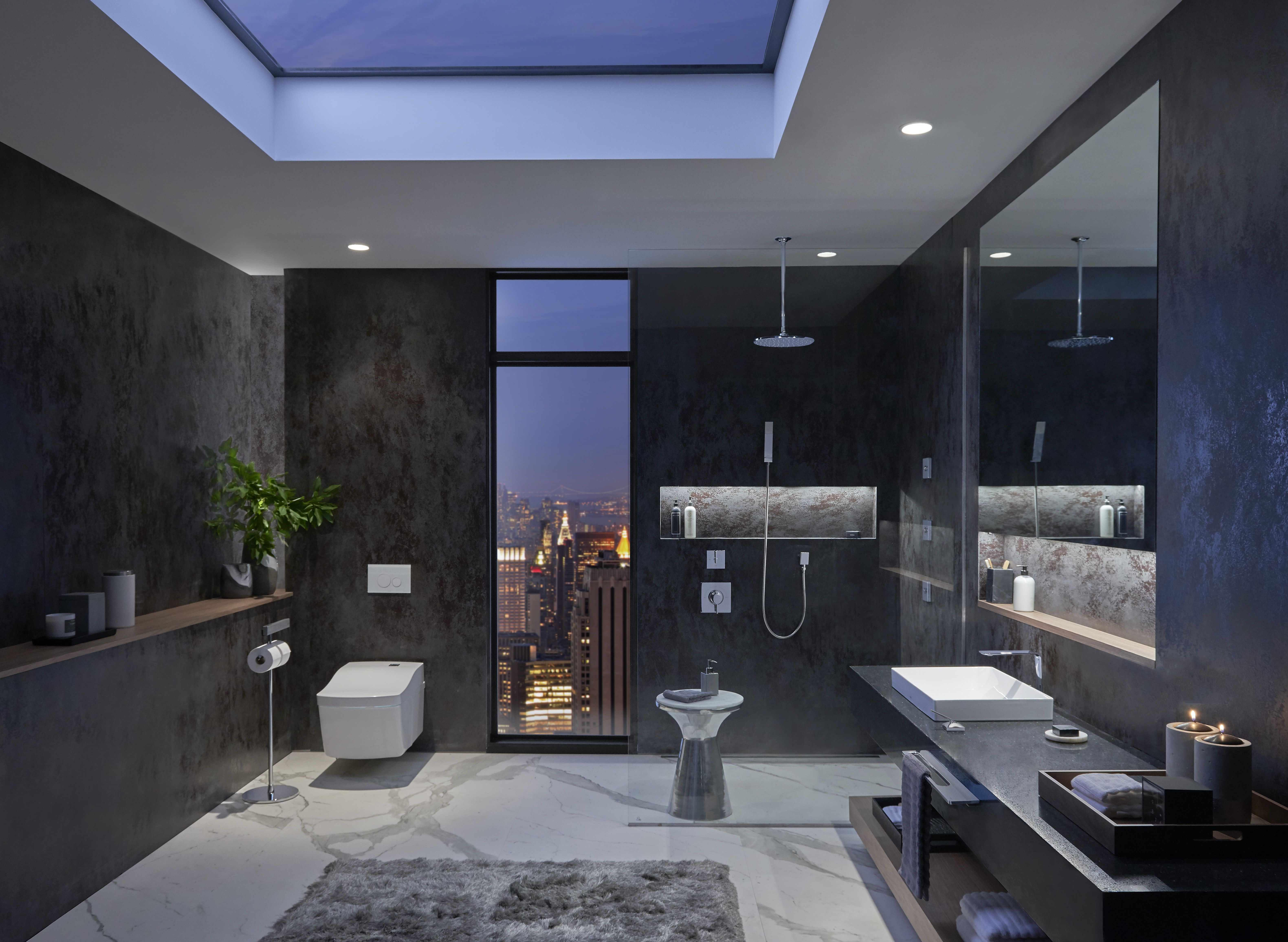 Dusk or dawn this modern bathroom design is enhanced with city views and innovative toto products bathroom bathroomreno bathroomgoals interiordesign