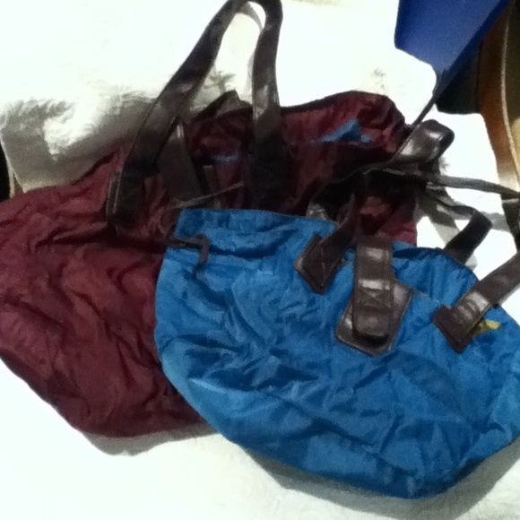 BOGO Big nylon tote with smaller baby Big water resistant tote in burgundy with at smaller version in teal blue. Excellent condition like new. Small scuff see photo Avon Bags Totes