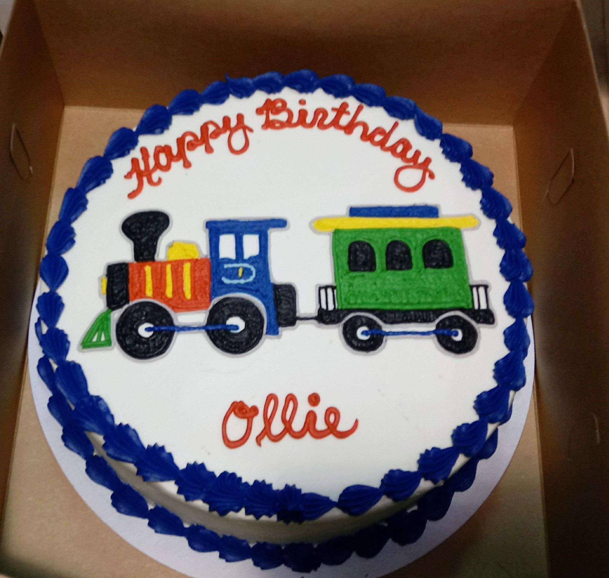 Colorful Train Engine And Caboose Drawn On A Birthday Cake For A