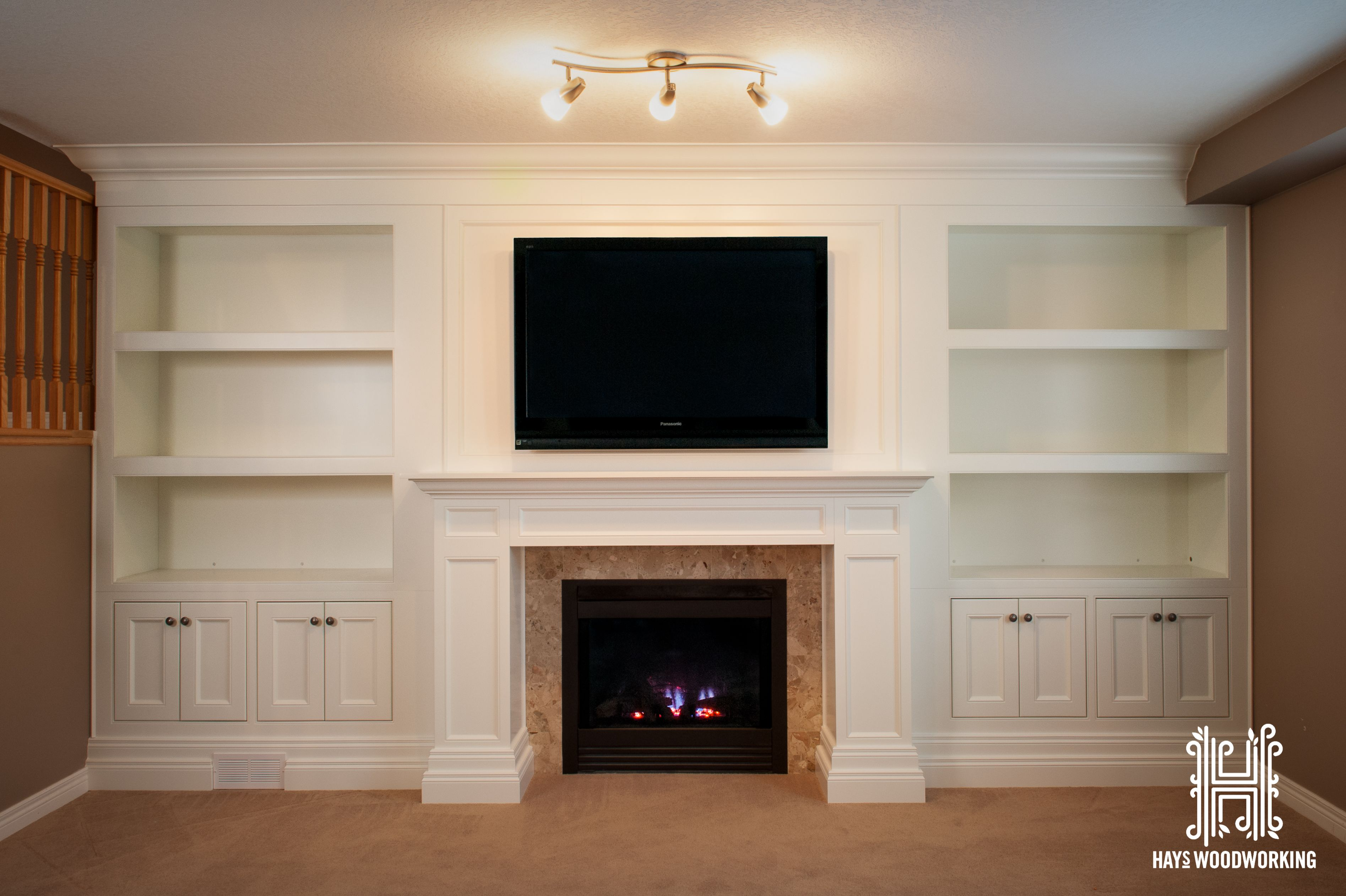 Builtin entertainment unit/fireplace mantle. Wall units