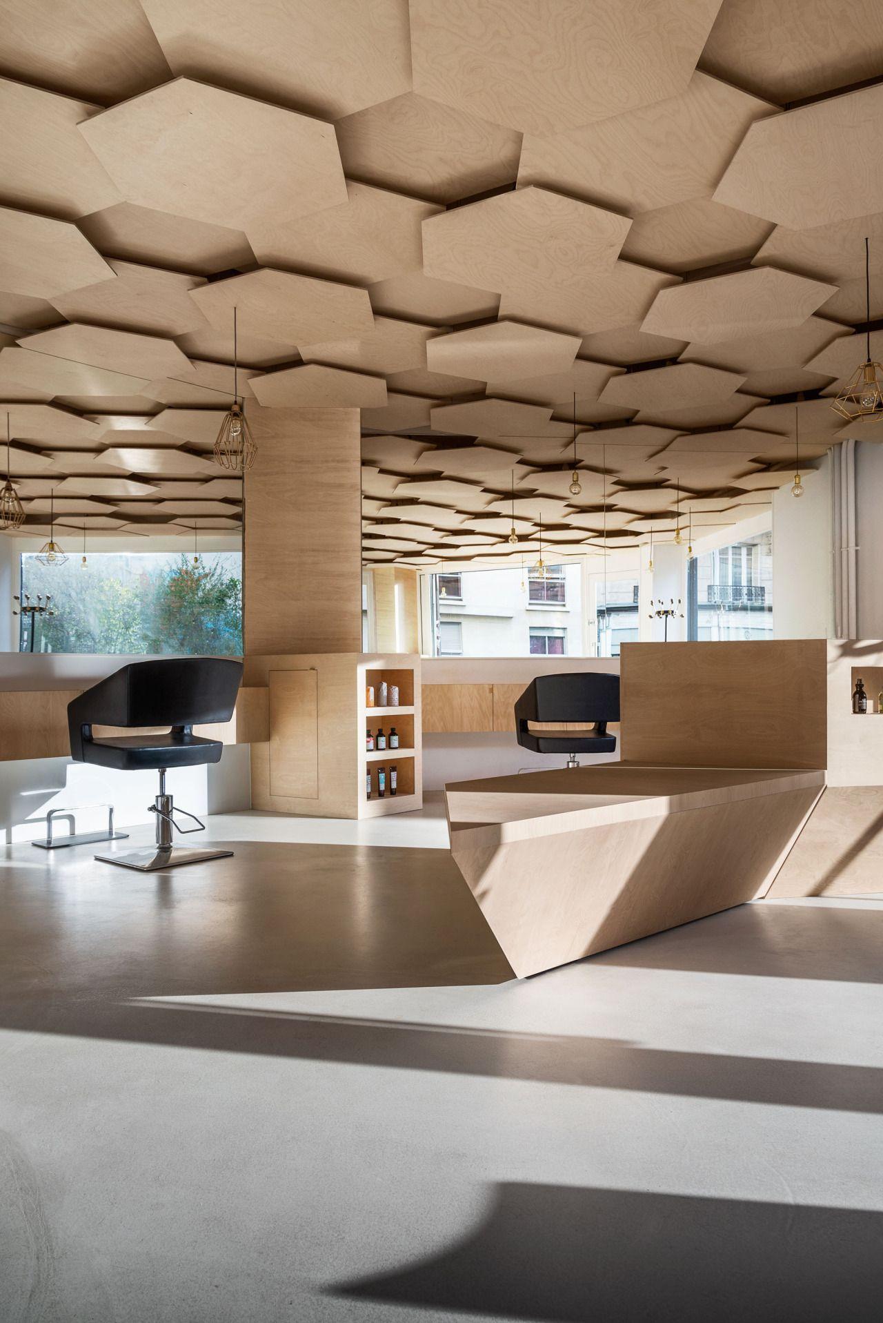 dezeen  Hexagonalpatterned ceiling added to Paris hair