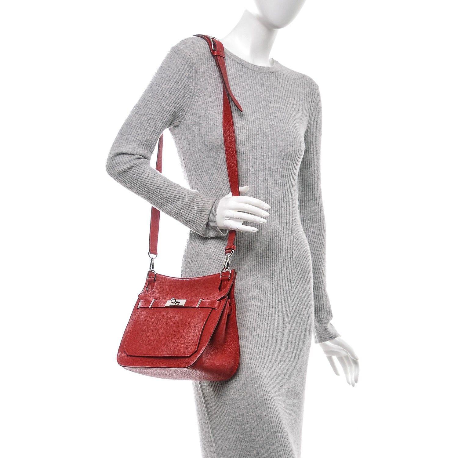 This is an authentic HERMES Taurillon Clemence Jypsiere Gypsy 28 in Rouge  Casaque. This stylish 166601d645bf2