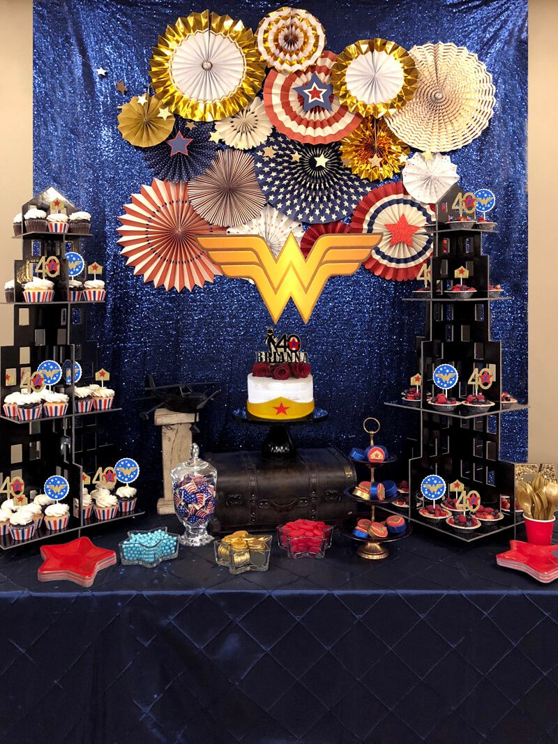 Have a big birthday coming up? Try a Classy Wonder Woman Party for grown up superhero fun. Create a stunning backdrop for your Wonder Woman dessert table using color coordinated party fans and glitter star garland. Skyscraper dessert towers and Wonder Woman logo are the finishing touch.