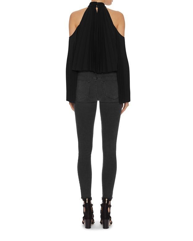 Exclusive for Intermix Perris Cold Shoulder Pleated Blouse: Accordion pleated bodice with cut outs at shoulders of long sleeves making a mixed statement of edgy chic. Three covered button closures at nape of high neckline. Keyhole back. In black. Fabric: 100% polyester Made in China.  Model Measurements: Height ...
