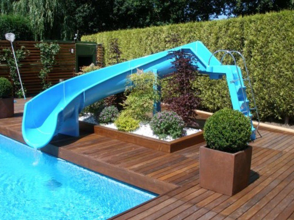 Outdoor pool with slide  Choosing The Right Outdoor Pool Slide | Pool slides, Outdoor pool ...