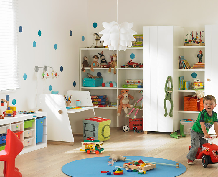 this modern playroom features plenty of toy storage | mini: play, Wohnideen design