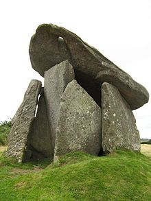 Trethevy Quoit - between St Cleer and Darite in Cornwall, England; it stands 9 feet high and consists of 5 standing stones capped by a large slab which has a natural hole; the back of the chamber has collapsed inwards; known locally as the 'giant's house'