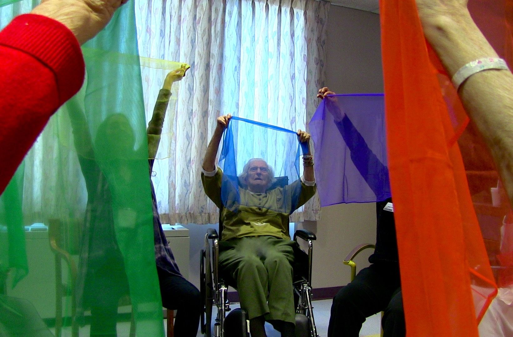Elders participate in a dance/movement therapy session at