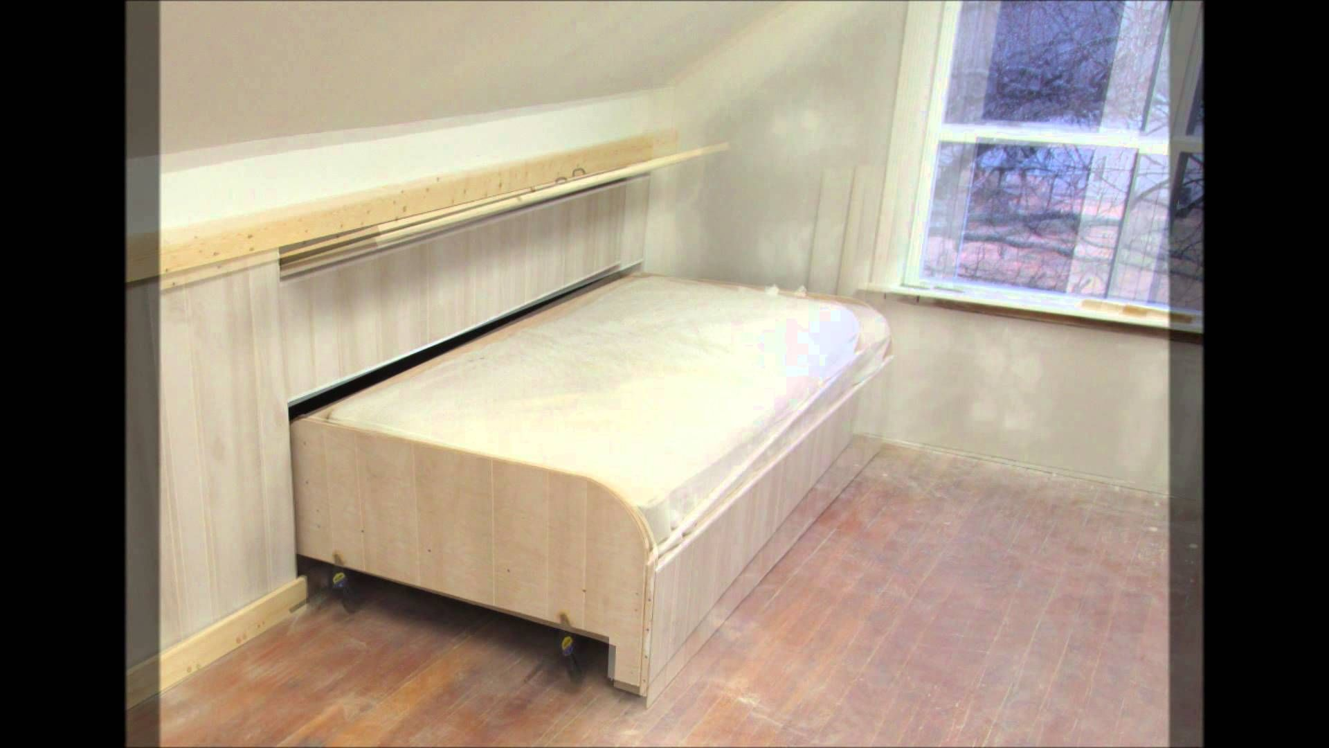 This pull out bed that tucks into the wall where the roof pitch gets short  is
