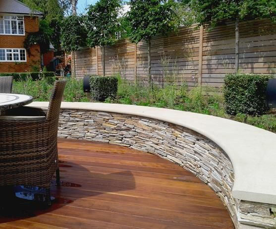 This long sweeping curve shows that with natural stone anything is these curved coping stones made from beige sawn sandstone were created especially for this garden by our stonemasons at the bespoke stone centre in west workwithnaturefo