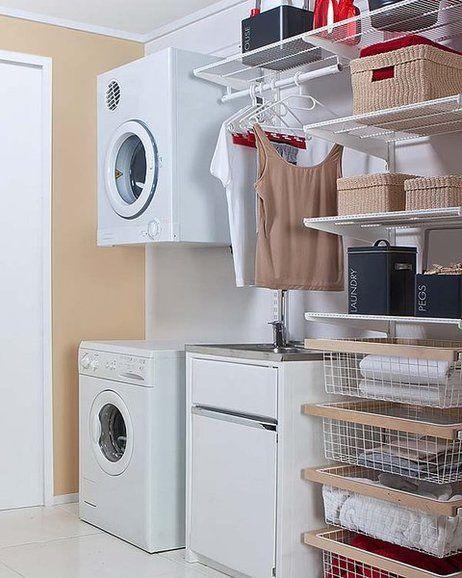 Lavadora con secadora colgada en la pared ba os for Bano con lavanderia