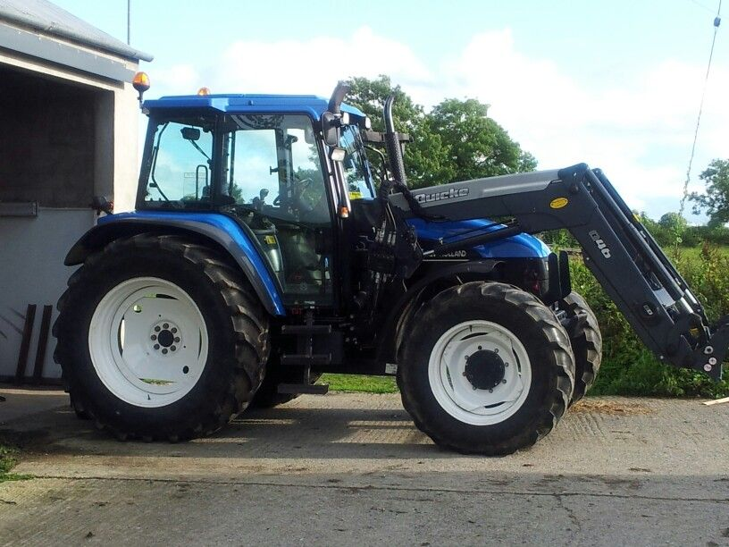 New Holland TS115 turbo with a Quicke Q46 front loader