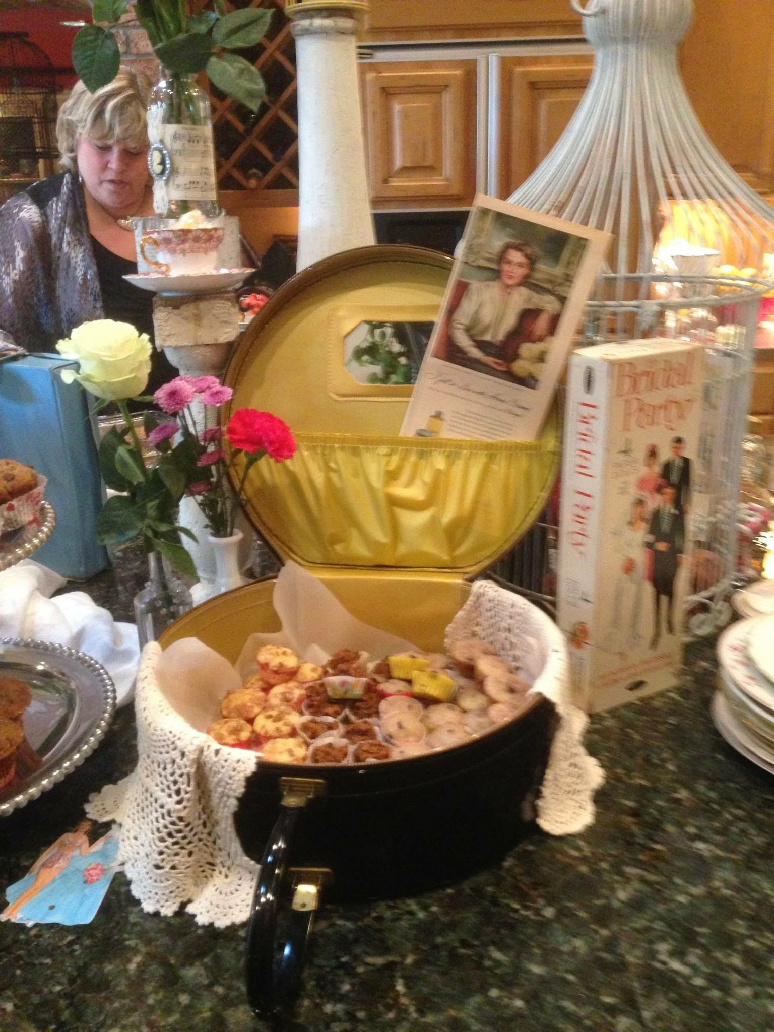 Vintage majorette marching band case used for muffin display at a vintage bridal shower breakfast buffet