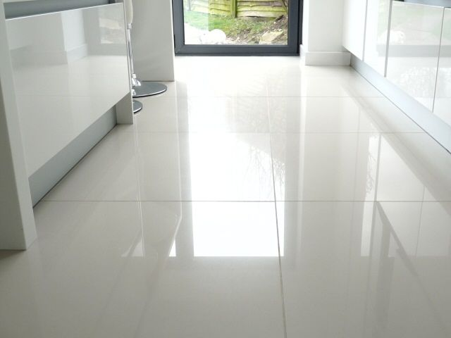Large white kitchen floor tiles we put shiny white tiles for Bathroom remodel under 5 000