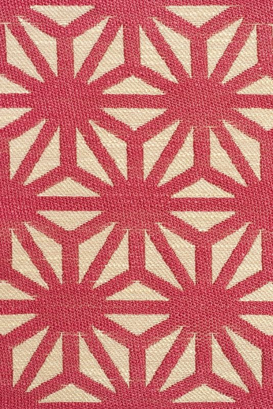 Starburst Woven Fabric A woven cloth with a geometric design in pink and  off white.