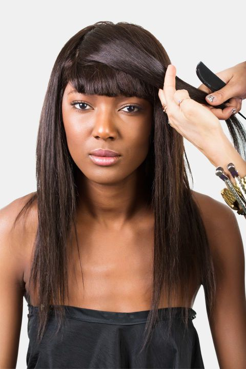 If your bangs are shorter, sweep a longer section of hair over them. Then tuck and secure with bobby pins or clips.