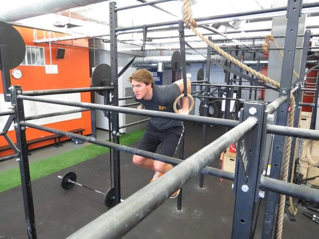 Founder Justin Quandt of The Foundry Gym Doing a Muscle Up