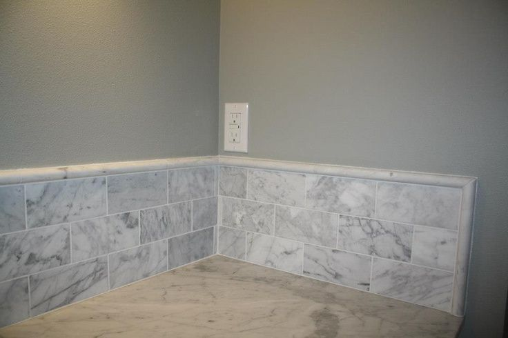 granite vanity carrara marble subway tile backsplash
