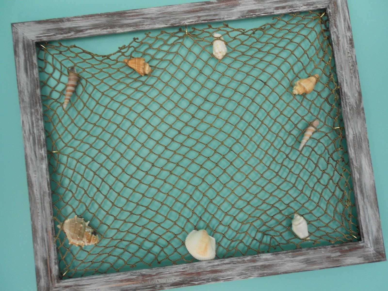 made with a discounted frame, paint, and a fish net www ...