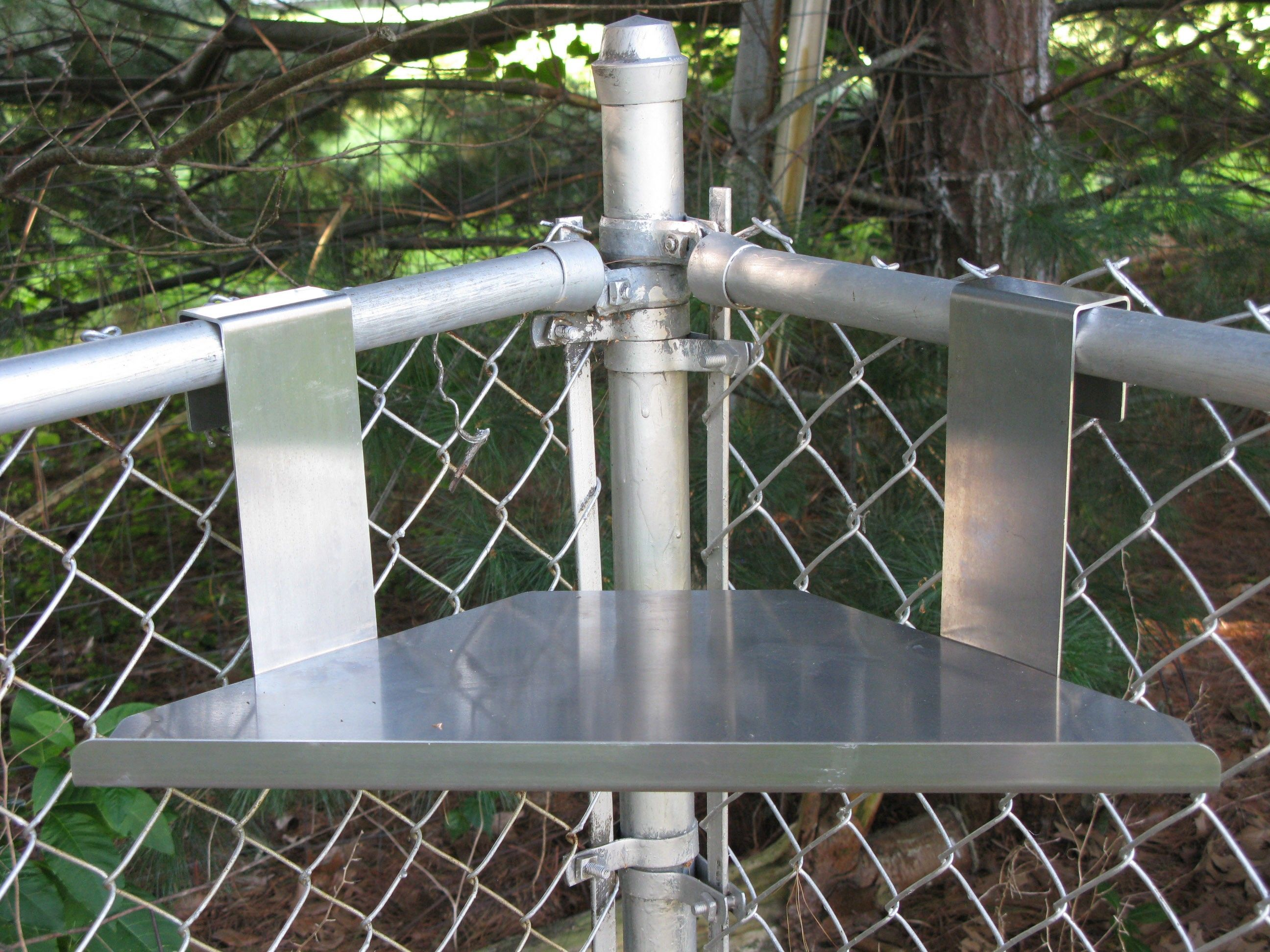 shelves in chain link fence - Google Search | Homeless Shelving Unit ...