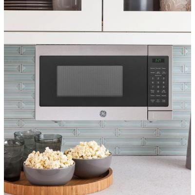 Ge 0 7 Cu Ft Small Countertop Microwave In Stainless Steel